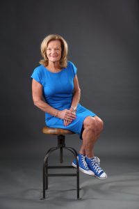 Headshots sitting forward with converse showing