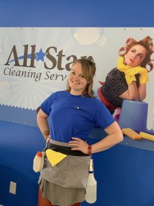 Laura Smith cleaner wearing apron